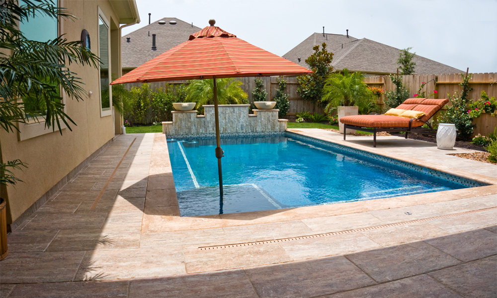 Outdoor swimming pools pool designs pool gallery design for Pool design katy tx